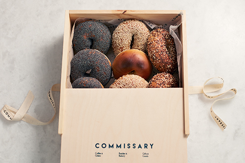 Photo of fresh bagels in a wooden box from Commissary Dallas